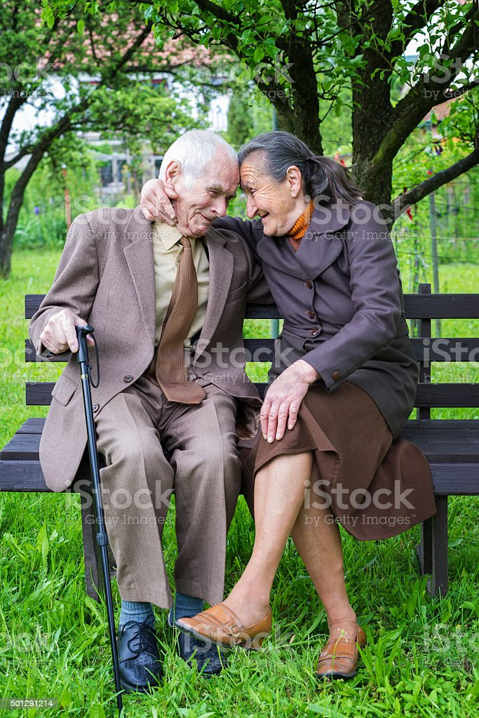 Cute 80 plus year old married couple portrait. Love concept. stock photo