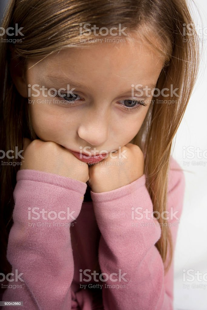 Cute adorable girl in deep thought stock photo