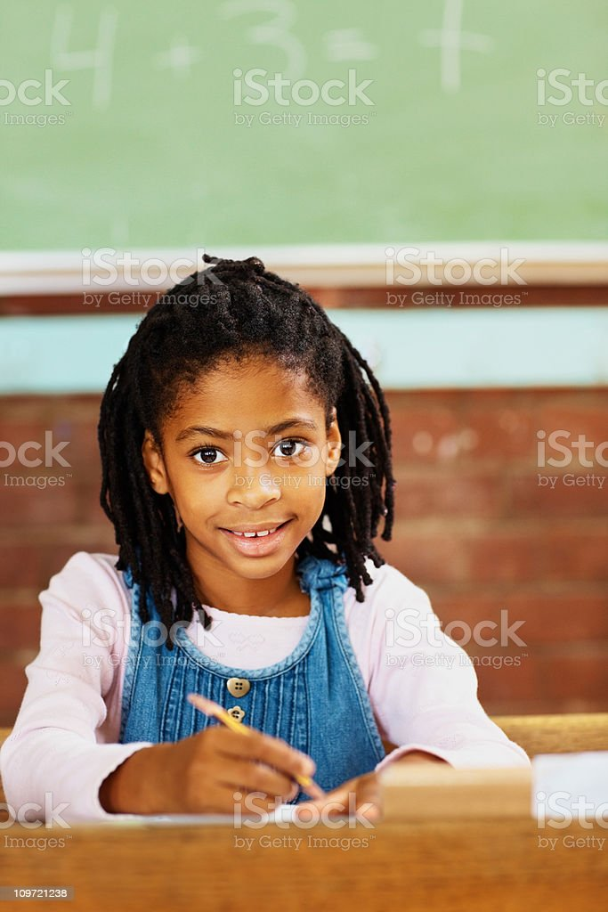 Cute African American girl in her classroom royalty-free stock photo