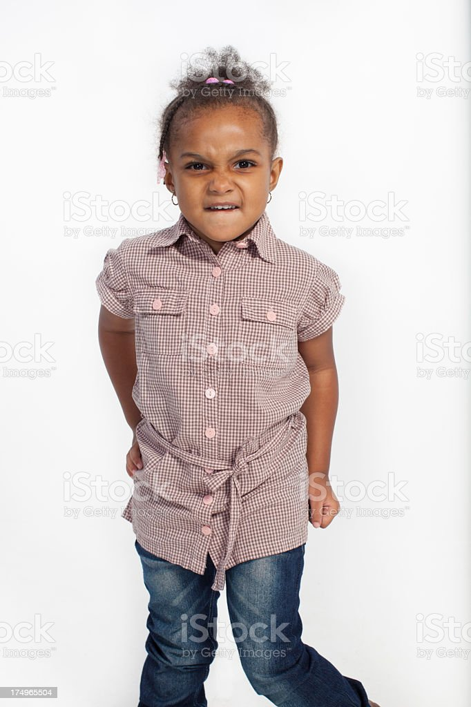 Cute African American girl with an angry look. royalty-free stock photo