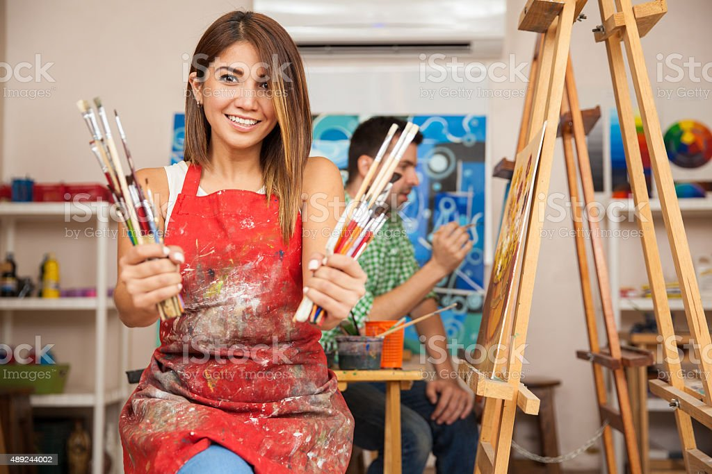 Cute art student loves to paint stock photo