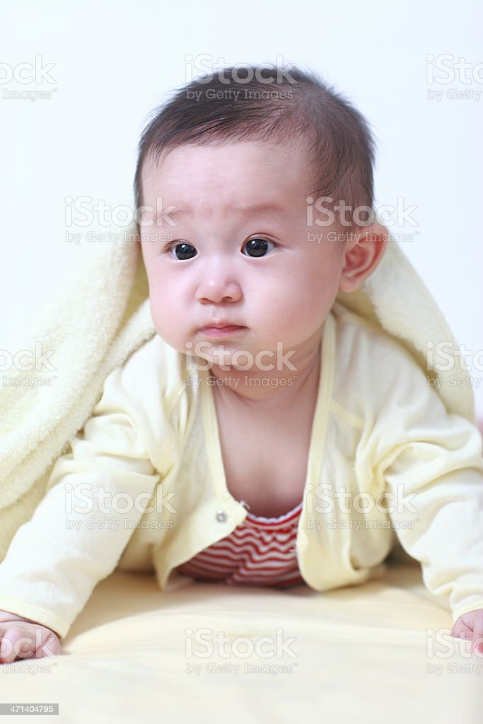 Cute asia baby on the bed royalty-free stock photo