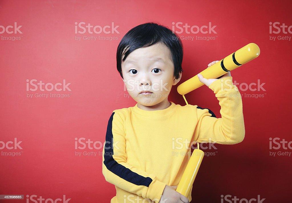 Cute asia child Kung Fu stock photo