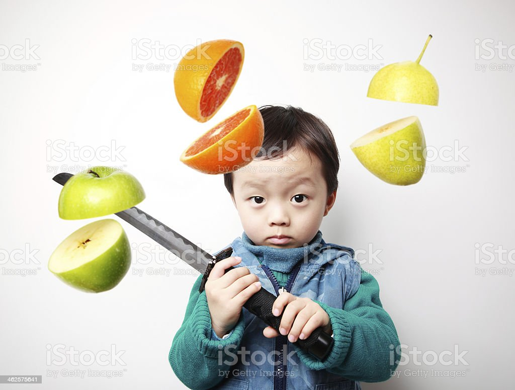 Cute asia children cut fruit stock photo