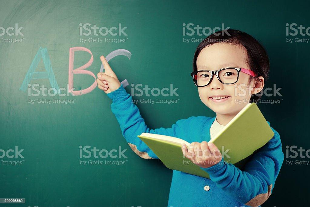 Cute asia children in the classroom stock photo