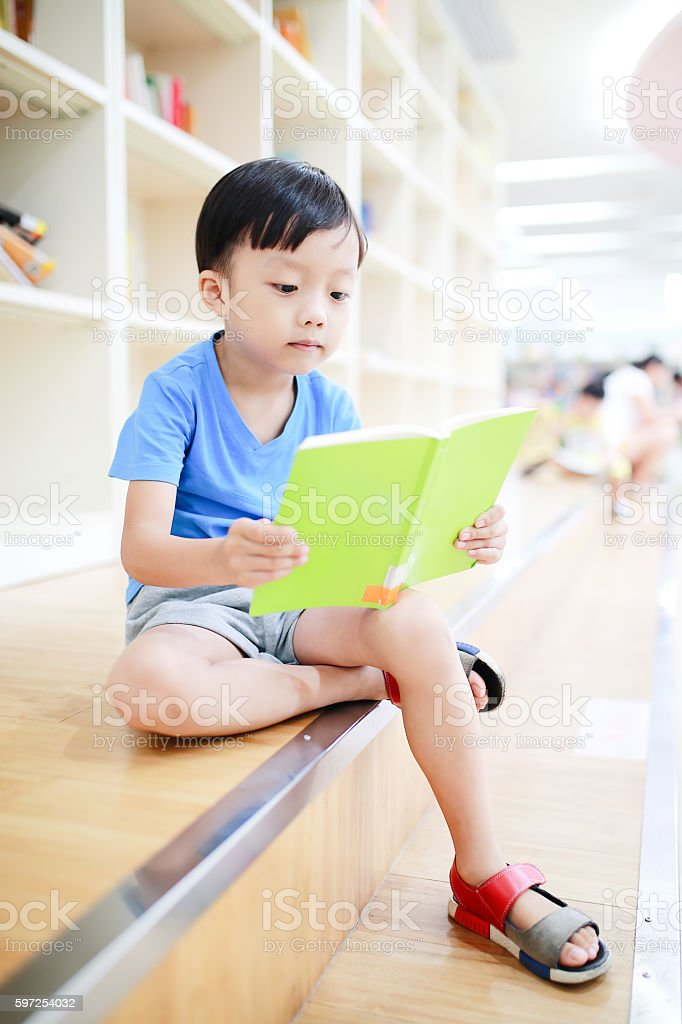 Cute asia children in the library stock photo