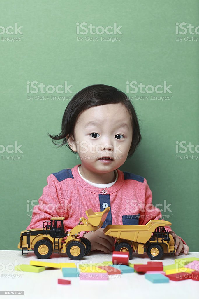 Cute asia children playing with toy cars royalty-free stock photo