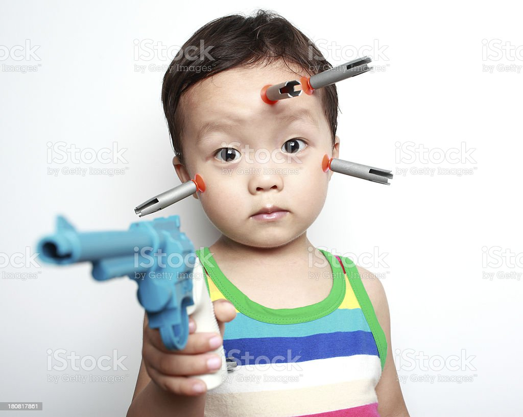 Cute asia children playing with toy gun royalty-free stock photo