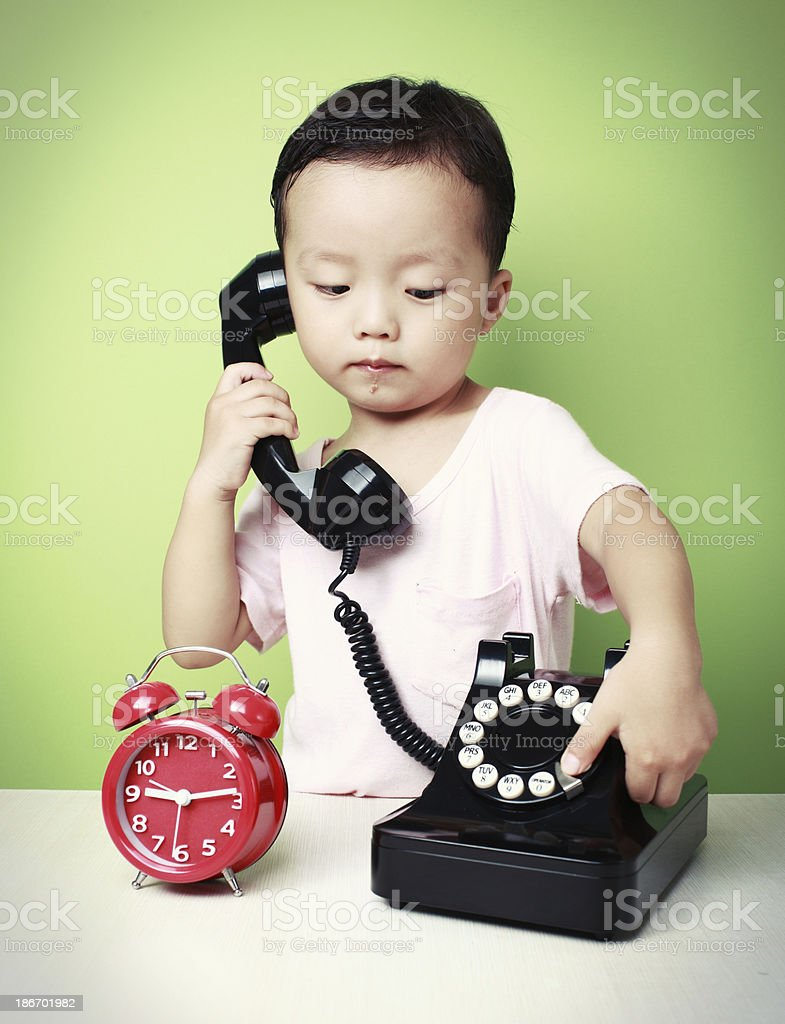 cute asia kid call royalty-free stock photo