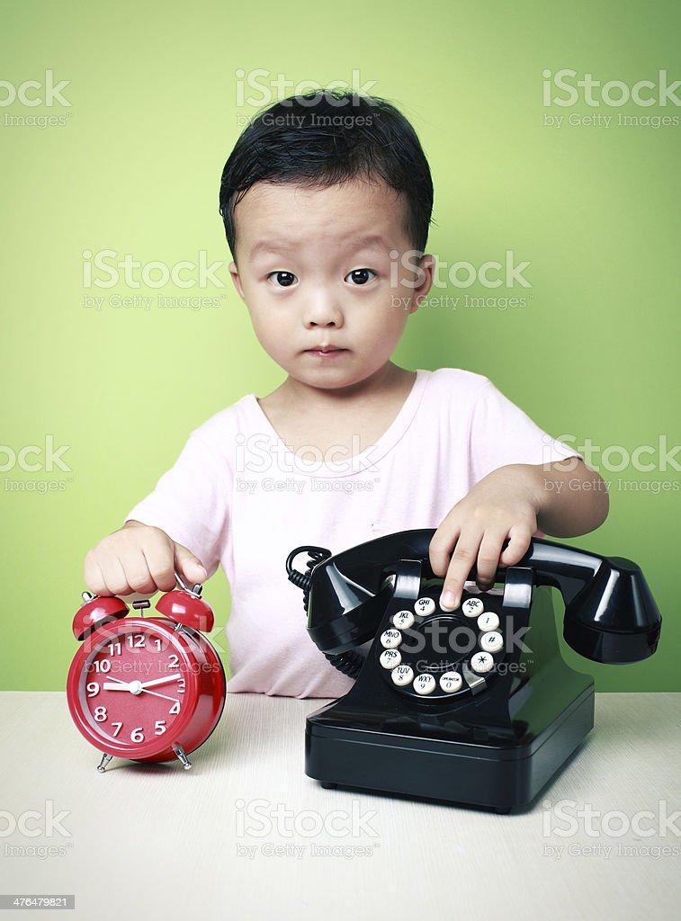 cute asia kid call royalty-free stock photo