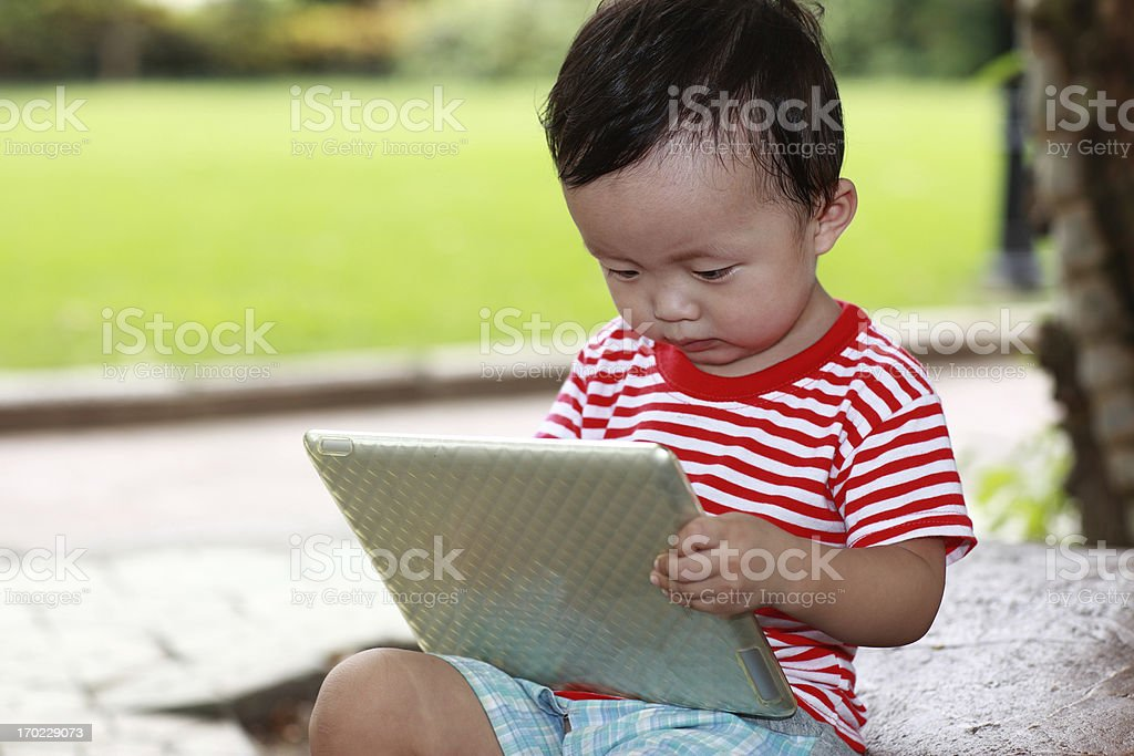 Cute Asian baby in the park royalty-free stock photo