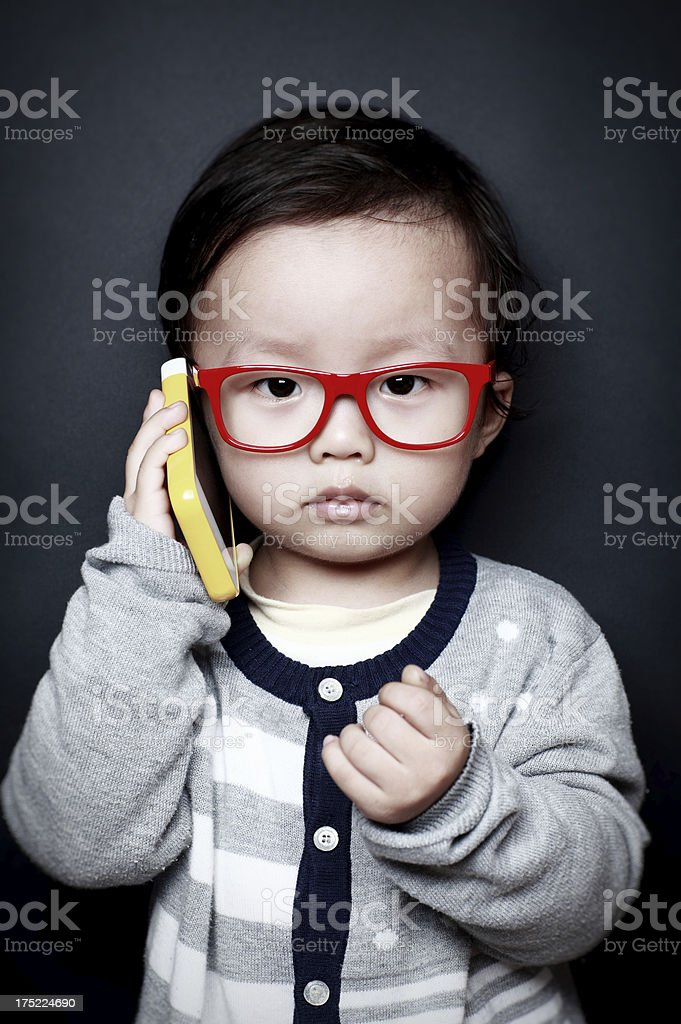 Cute Asian baby  Mobile phone royalty-free stock photo