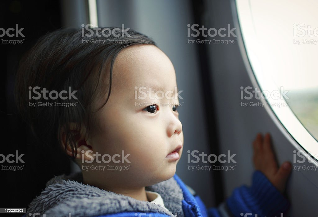 Cute Asian baby Take the train royalty-free stock photo