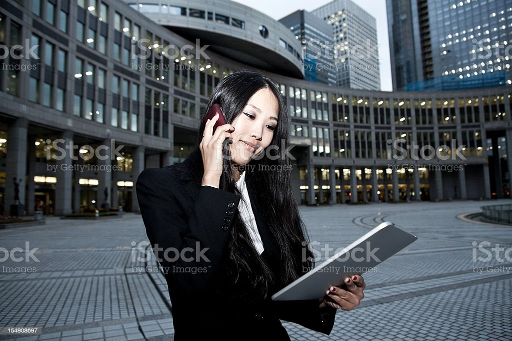 Cute asian business woman at the streets royalty-free stock photo