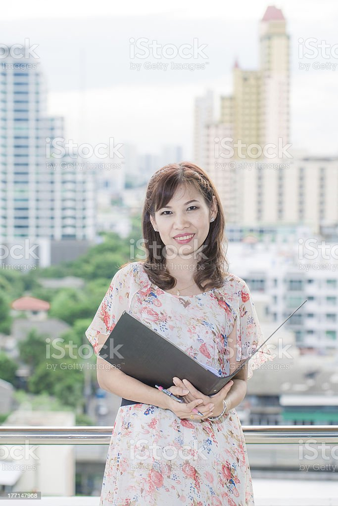 Cute asian businesswoman portrait in office with her file royalty-free stock photo