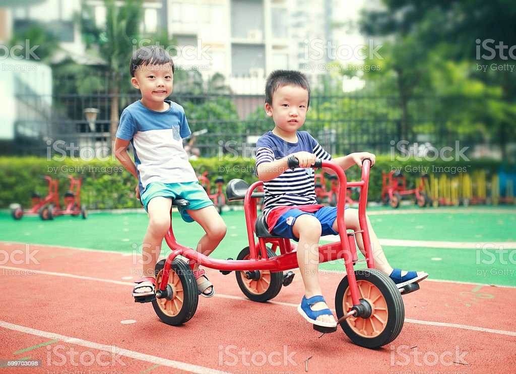 Cute Asian child in the Playground stock photo