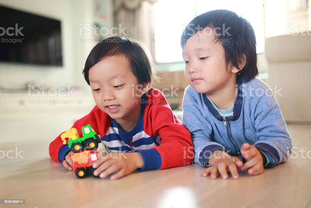 Cute Asian children and toy car stock photo