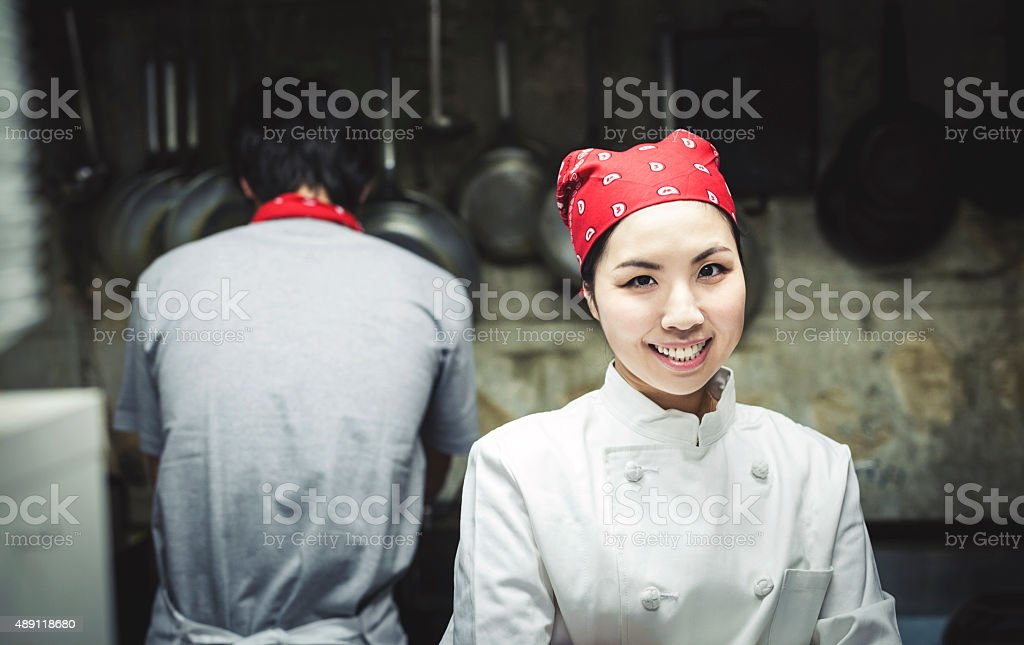 Cute Asian Cook in the Kitchen stock photo