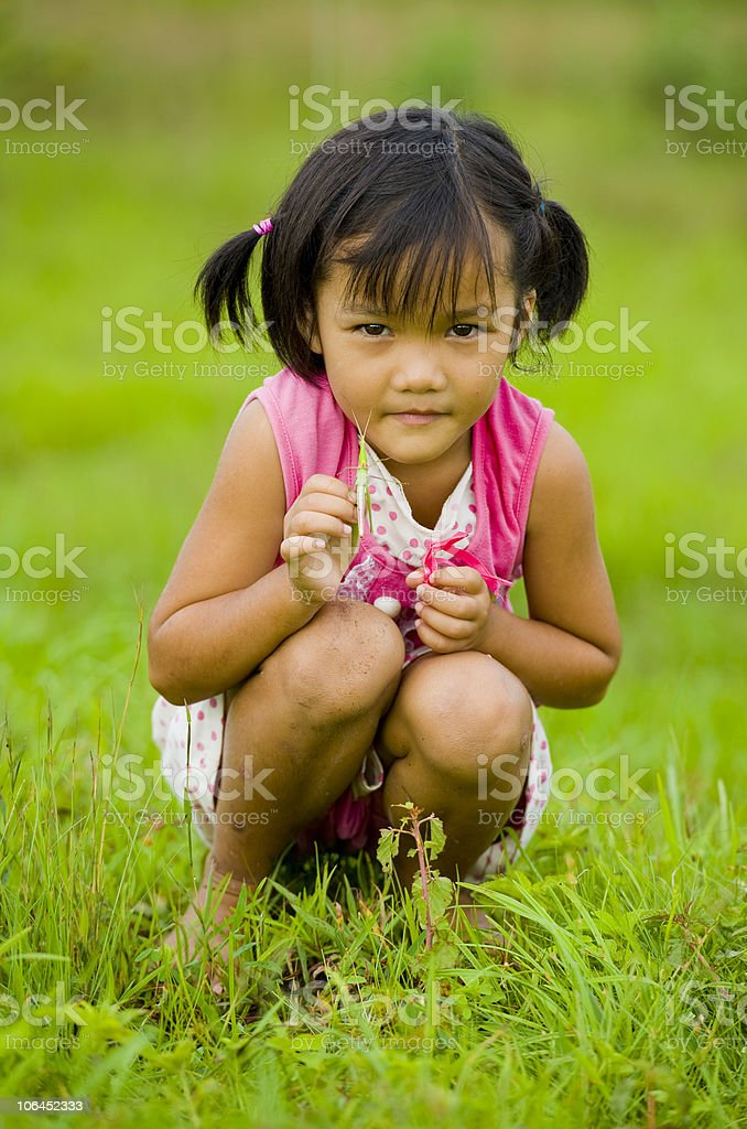 cute asian girl holding a grasshopper royalty-free stock photo