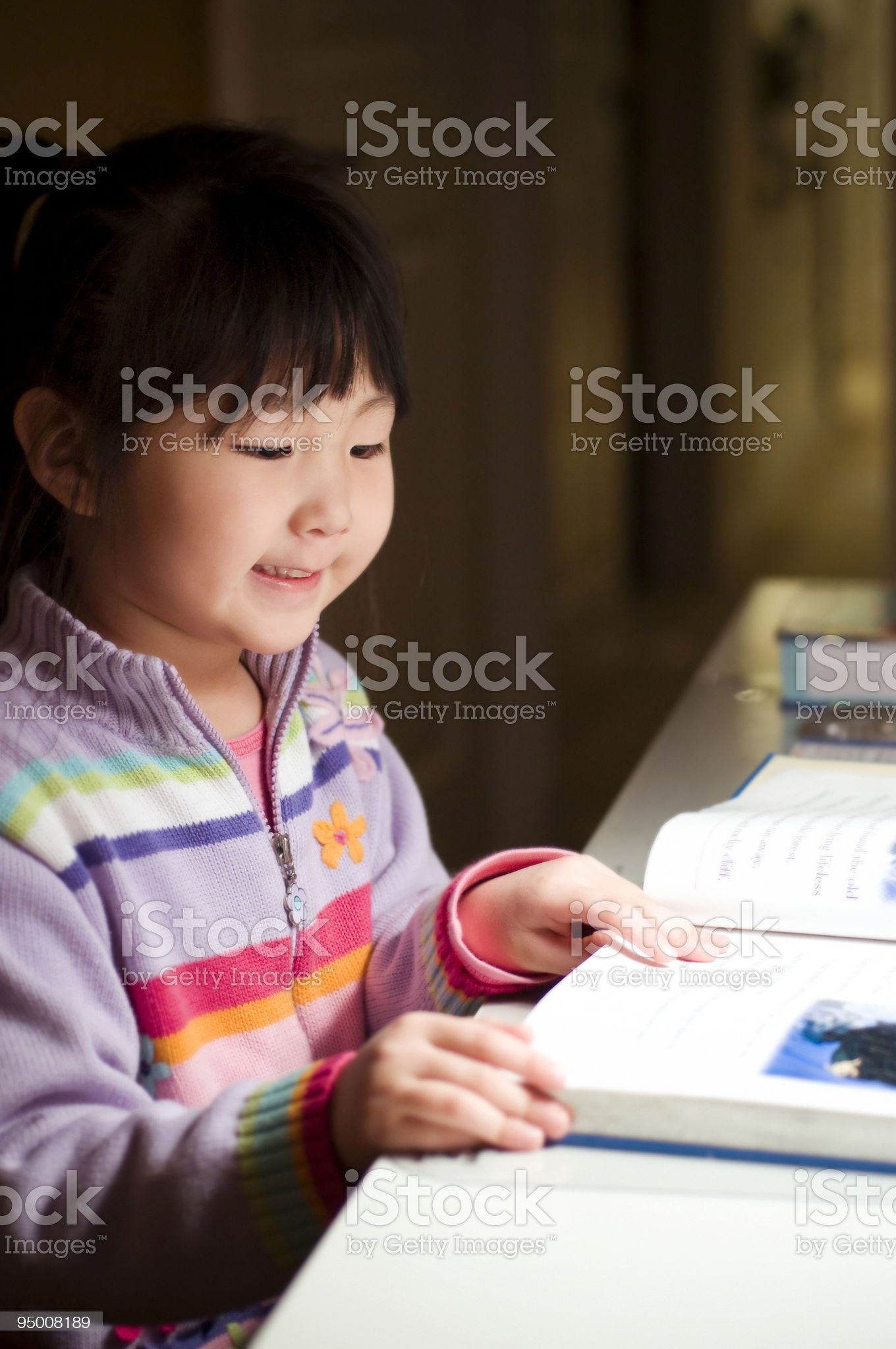 Cute Asian Girl Reading Book royalty-free stock photo