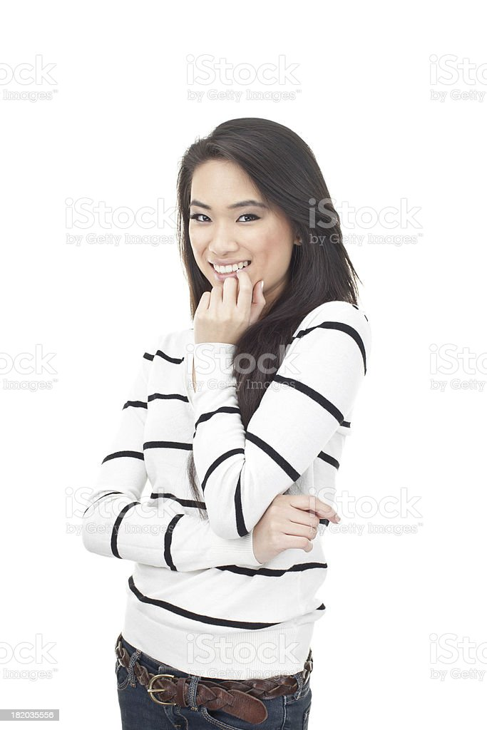 cute asian girl smiling and biting nail royalty-free stock photo
