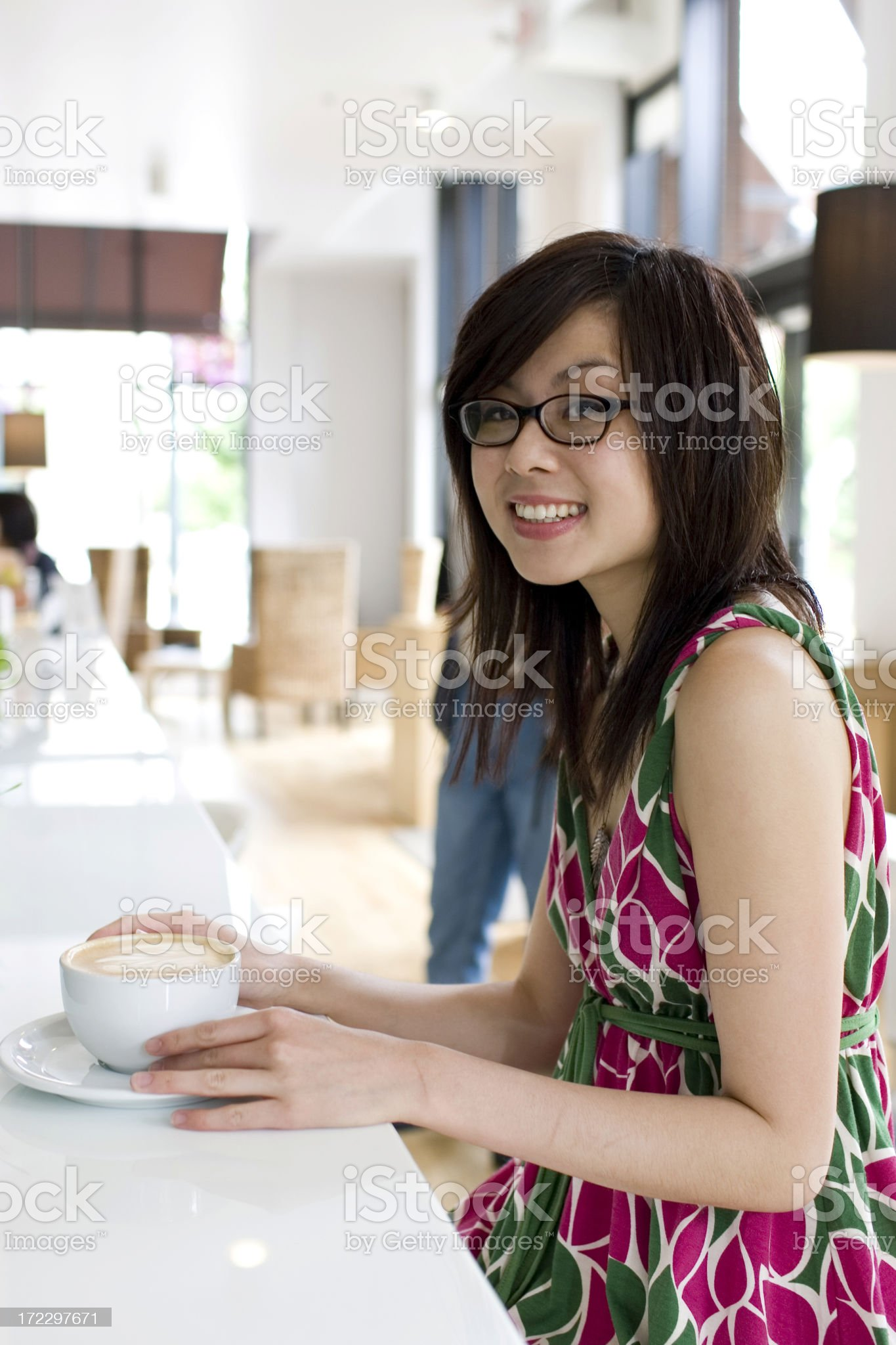 Asian Beautiful Young Woman Wearing Glasses in Coffee Shop, Copyspace royalty-free stock photo