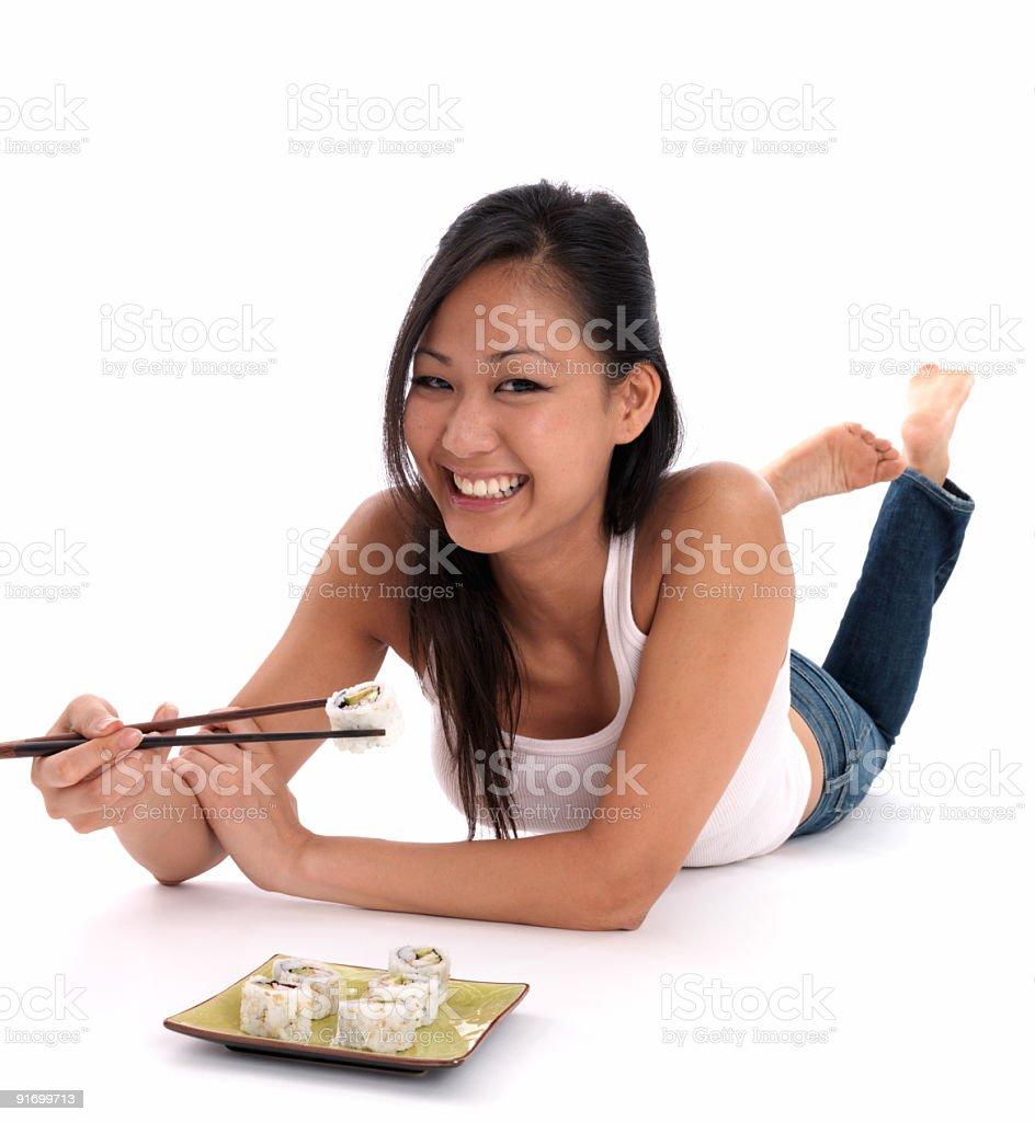 Cute Asian woman enjoying Sushi royalty-free stock photo