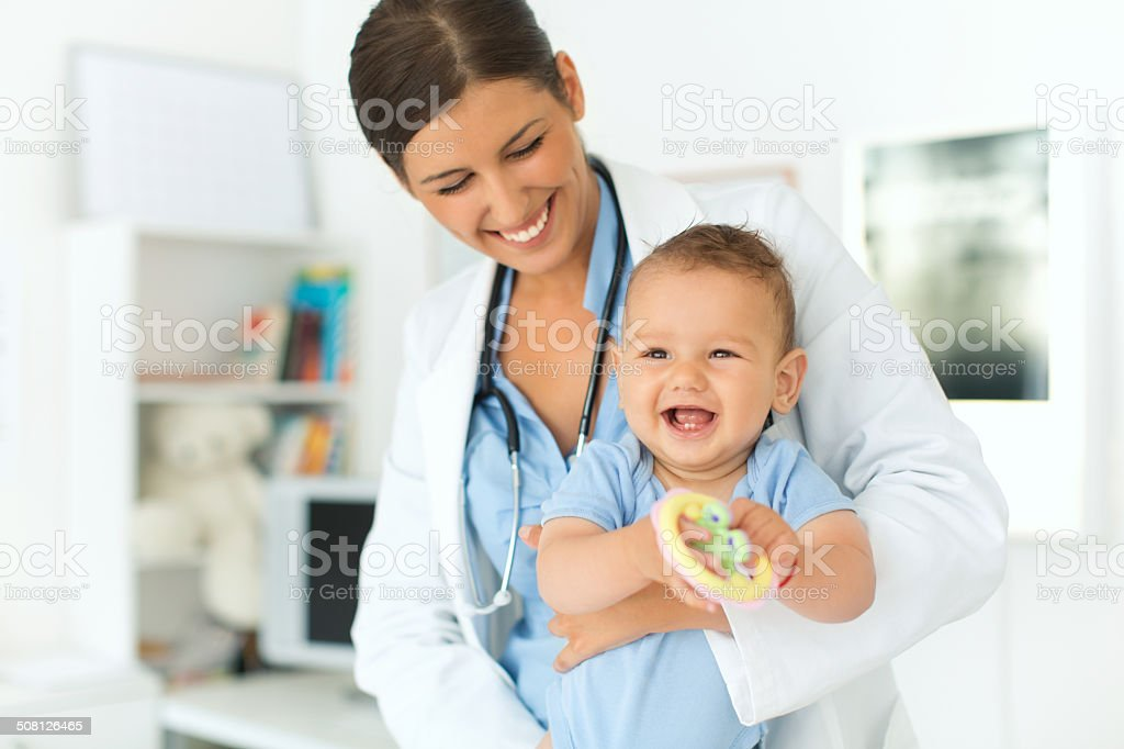 Cute baby boy at doctor's office. stock photo