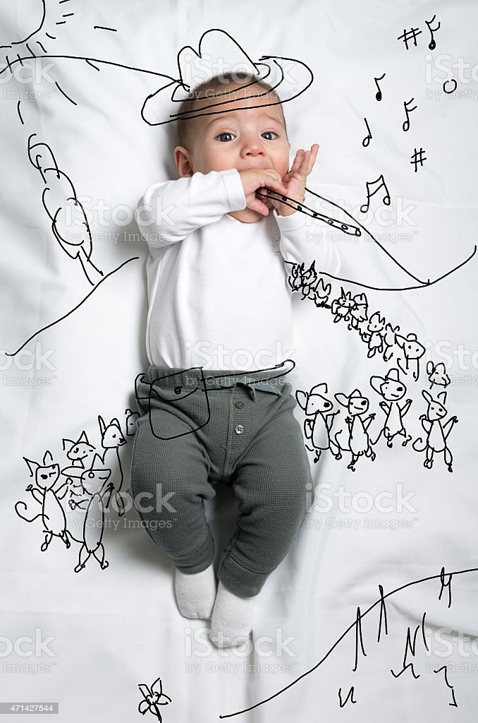 Cute baby boy depicting pied piper decoration sketch stock photo