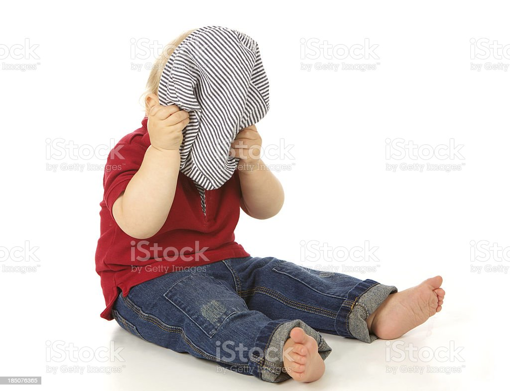 Cute Baby Boy Hiding His Face with Hat royalty-free stock photo