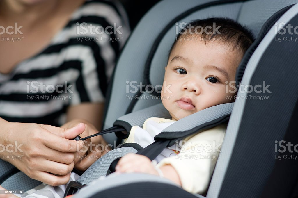 Cute baby boy in safety seat. stock photo