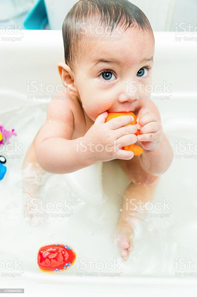 Cute baby boy in the bathtub stock photo