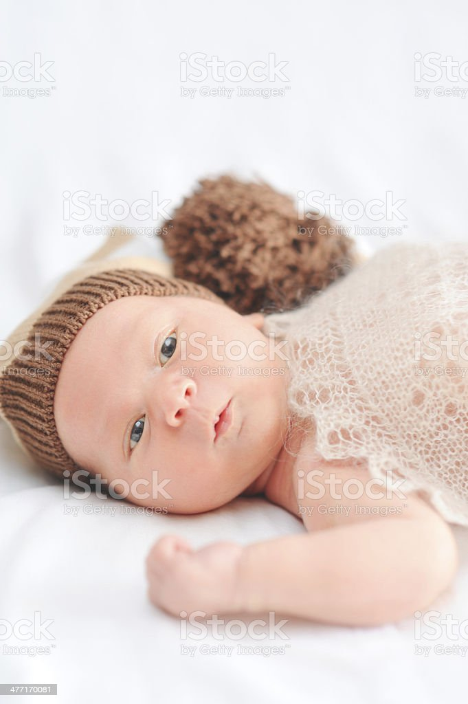 Cute baby boy lying on bed royalty-free stock photo