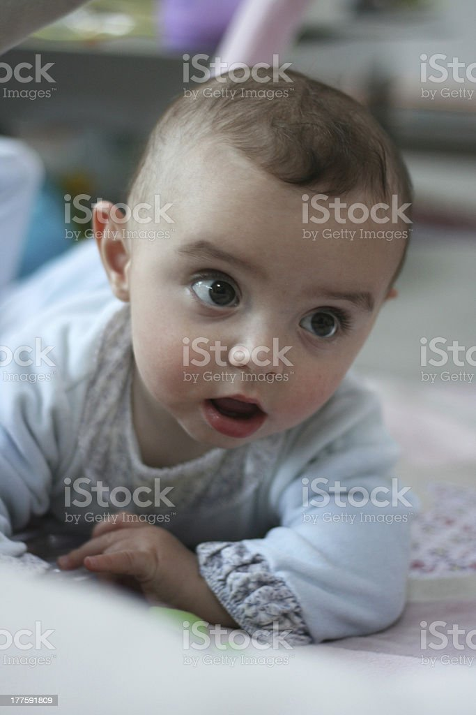 Cute baby crawling on the floor. royalty-free stock photo