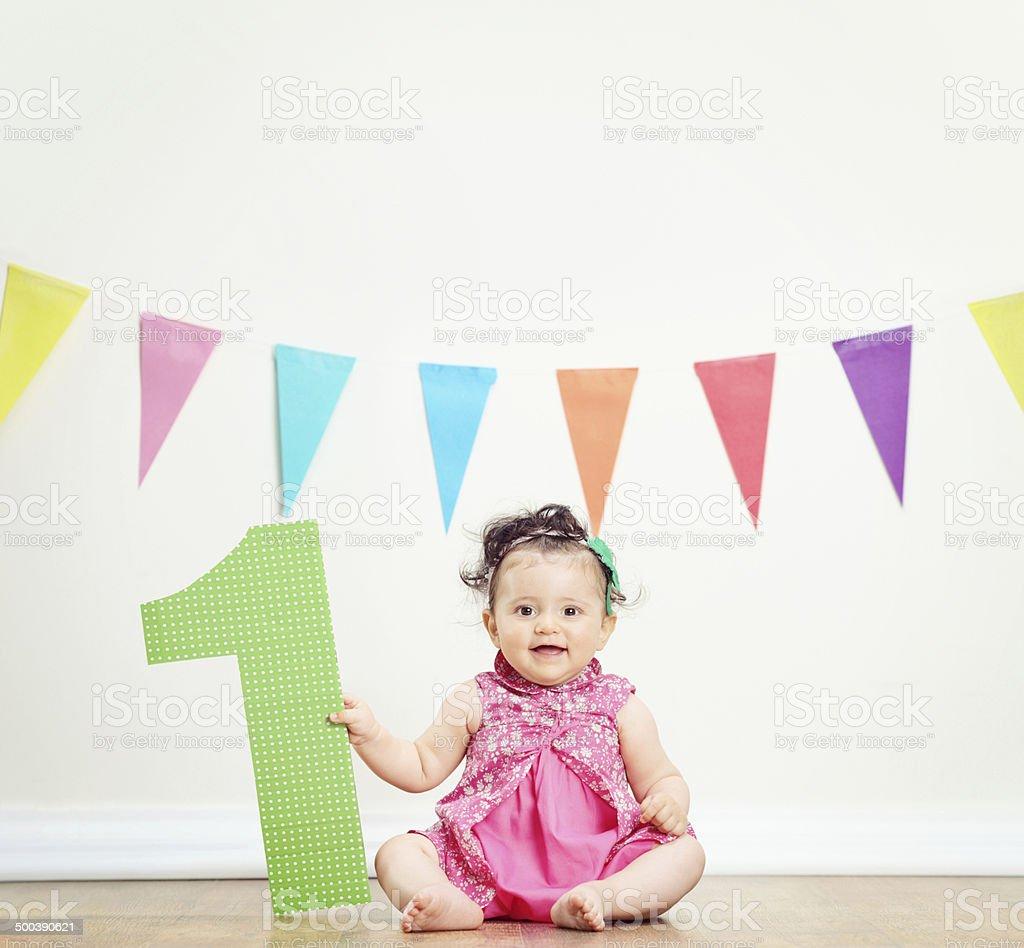 Cute baby girl celebrating her first birthday stock photo