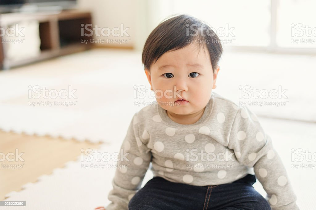 Cute baby girl in house stock photo