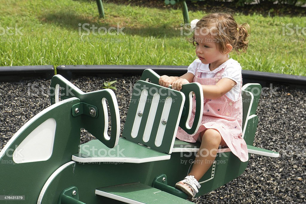 Cute baby girl on playground royalty-free stock photo