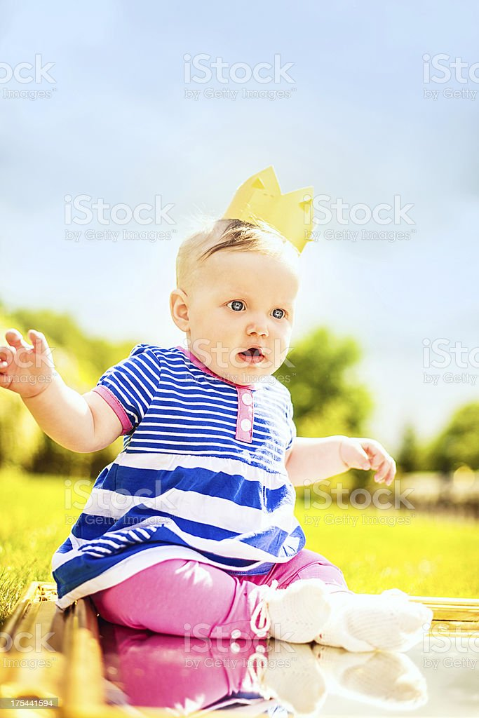 Cute baby girl outdoors with mirror royalty-free stock photo