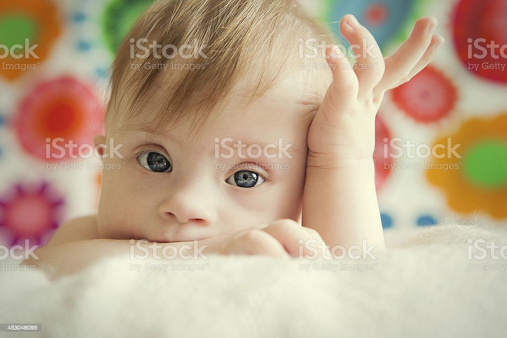 A cute baby girl posing for picture stock photo