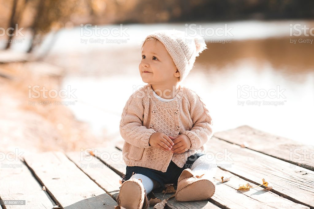 Cute baby girl resting outdoors stock photo