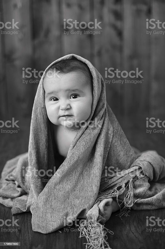 Cute Baby Girl Sitting While Wrapped in Blanket royalty-free stock photo