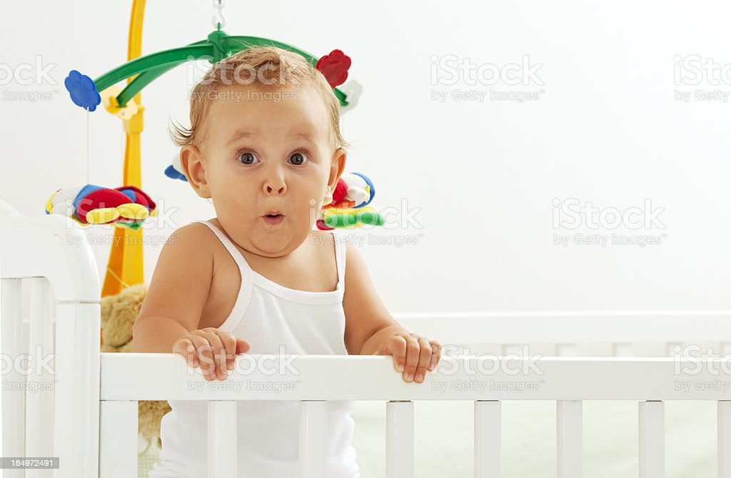 Cute Baby Girl Surprise Portrait in the crib stock photo