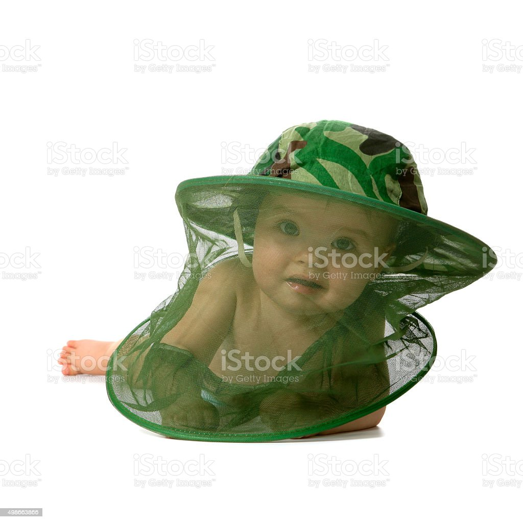 Cute baby in mosquito net hat stock photo