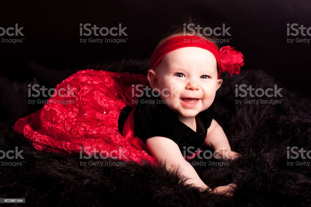 cute baby in red dress stock photo