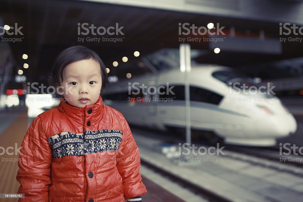 Cute baby in the train. royalty-free stock photo