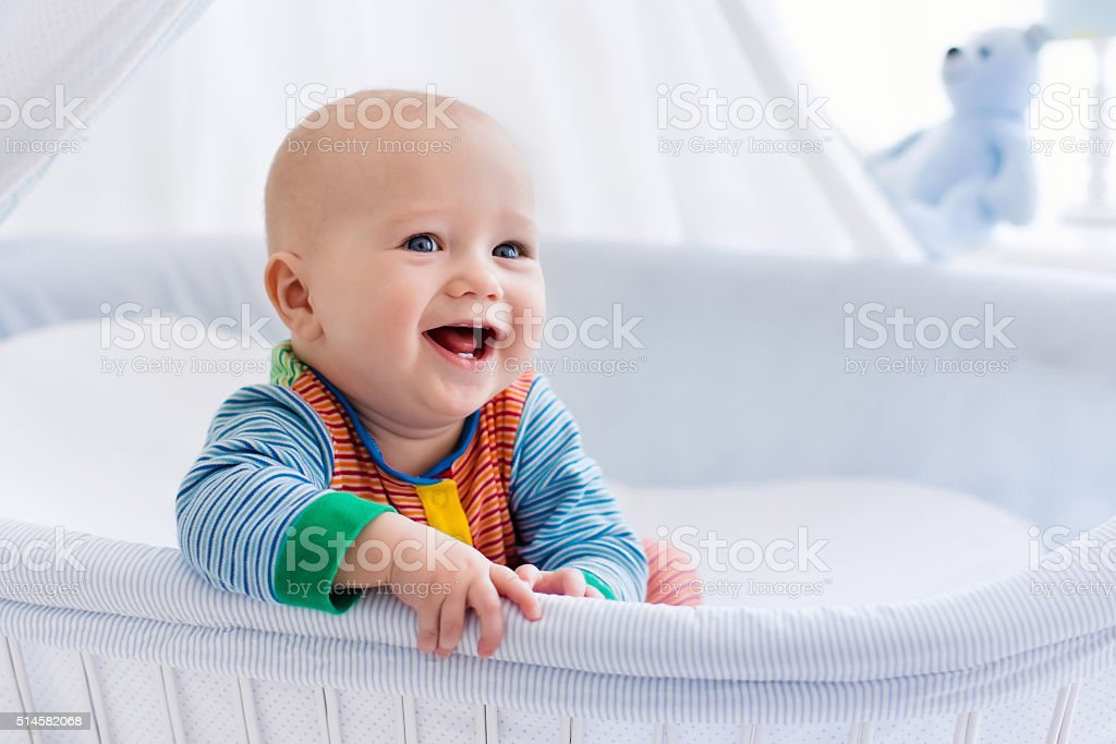 Cute baby in white nursery royalty-free stock photo