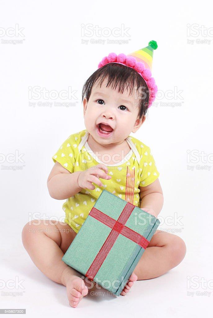 Cute baby laughing wearing party hat Lizenzfreies stock-foto