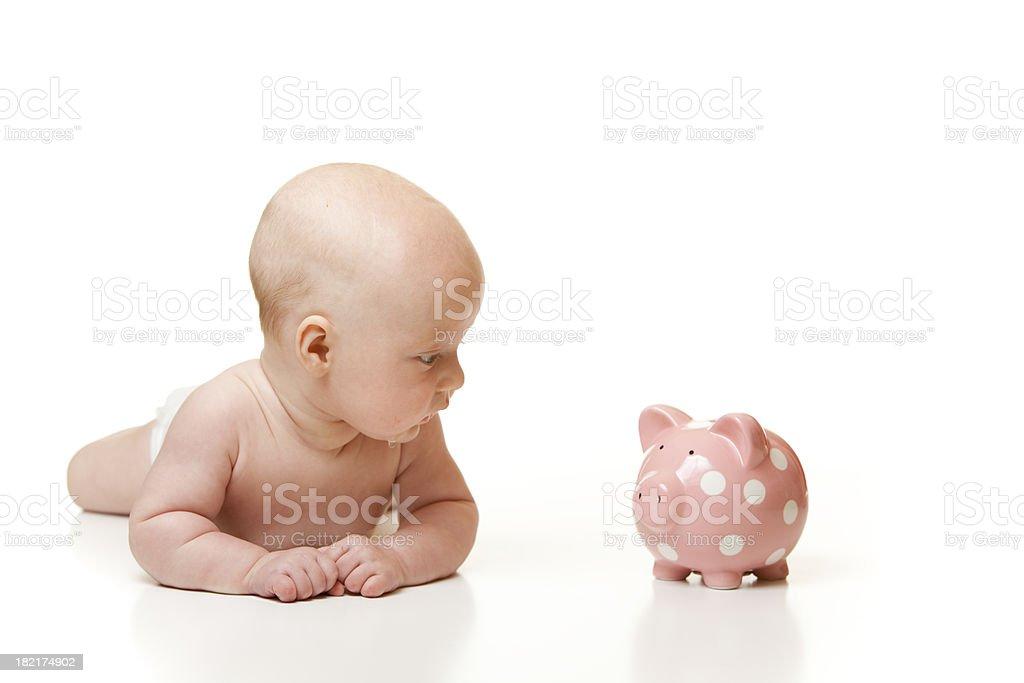 Cute Baby Looking at Piggy Bank royalty-free stock photo