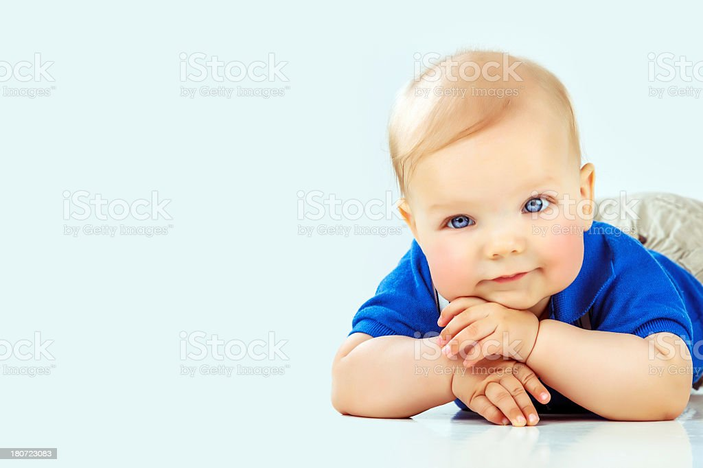 Cute baby lying on front stock photo
