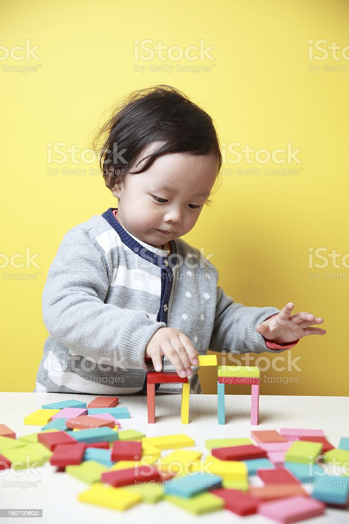 cute baby play with blocks royalty-free stock photo